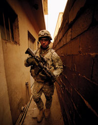 A U.S. Army soldier patrols an alleyway in Diyala province, Iraq, in 2009.
