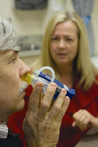 Dr. Bill Banks of the VA Puget Sound Healthcare System demonstrates a nasal applicator used to deliver insulin-or potentially other therapeutic substances-quickly and directly to the brain. Looking on is lead researcher Dr. Suzanne Craft