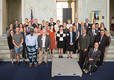 Dr. Carolyn Clancy stands with a distinguished group of VA scientists at the inaugural VA Research Day on the Hill in Washington D.C., held on June 19, 2018.