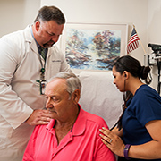 Instructor Dr. Randy Moore (left) and recent nursing graduate Chenoa Leopard meet with Birmingham VA patient 