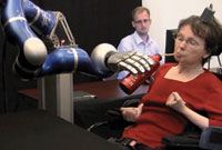 A 58-year-old Massachusetts woman who suffered a paralyzing brainstem stroke 15 years ago while working in her garden was able to serve herself coffee using the BrainGate system and a robotic arm.
