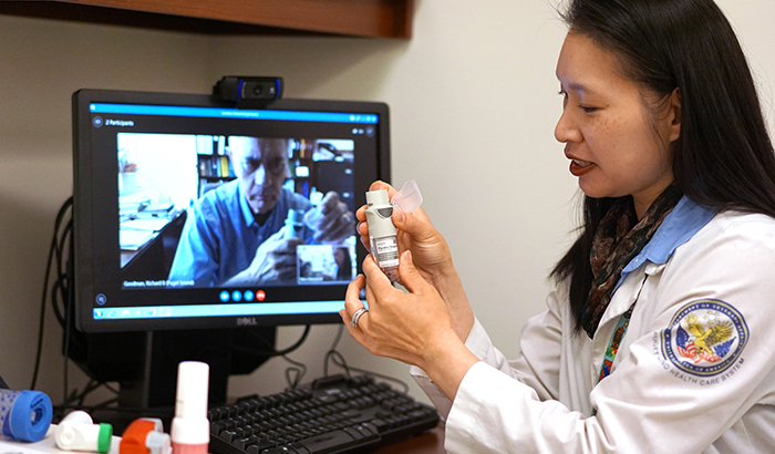 Pharmacist Deborah Woo demonstrates the video-training technique used in the study. (Photo by Chris Pacheco)