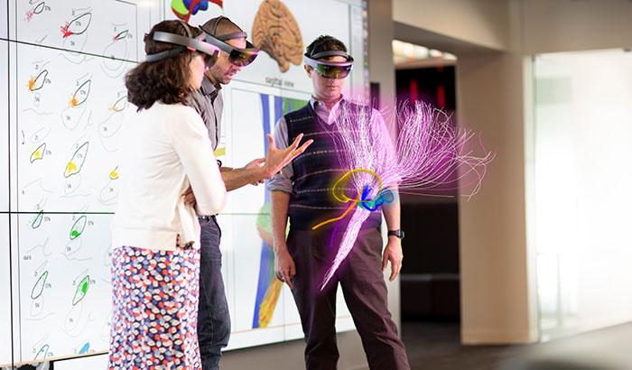 Drs. Cameron McIntyre (center) and Aasef Shaikh (right) study brain pathways through the HoloLens with neurology colleague Dr. Camilla Kilbane. The photo shows what is seen through the HoloLens glasses. (Photo provided by Cleveland FES Center)