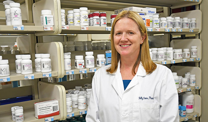 Kelly Davis (pictured in pharmacy), a pharmacist at the Lexington VA Medical Center in Kentucky, is part of a team working to reduce inappropriate use of proton pump inhibitors. (Photo by Candace Woods)