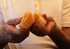 Mindfulness programs typically include exercises in mindful eating. Rather than rush mindlessly through the experience of eating an orange, for example, participants are taught to think about where the fruit came from, and to slowly and deliberately savor its appearance, scent, texture, and taste. (Photo by Mitch Mirkin)