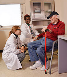Dr. Rina Eisenstein (left) a primary care physician on the GeriPACT team at the Atlanta VA, talks with patient Henry Holley, who served in the Marines. With them is nurse care manager Cathy Woods. (Photo by Joey Rodgers)