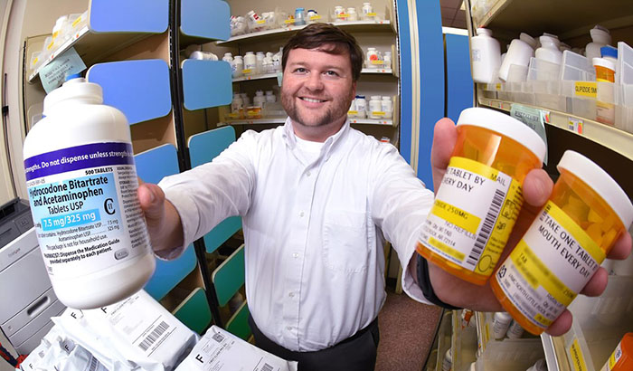 Pharmacist Dr. Corey Hayes and colleagues found that higher opioid doses did not bring more pain relief—but did increase the risk of harmful side effects. (Photo by Jeff Bowen)