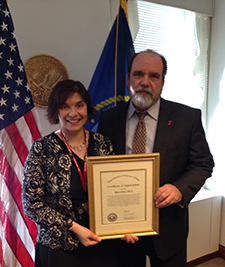 Dr. Robert Jesse, a former VA principal deputy undersecretary for health, presents Rani Elwy with a certificate of appreciation in 2014 for the work she and her team did to improve how VA responds to adverse events.