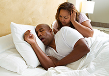 Snoring is one of the signs of sleep apnea, although not all people who snore have the condition.