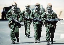 Troops from the 82nd Airborne Division wear protective gear as they try to acclimate to the heat of the Saudi summer during Operation Desert Shield. <em>(Photo by Staff Sgt. F. Lee Corkran/USAF)</em>