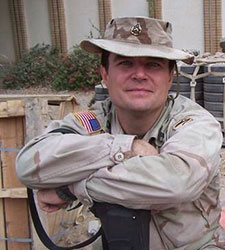Lance Caver takes a break between patrols in Baghdad, Iraq, in 2004