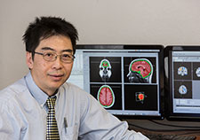 Dr. Mingxiong Huang is a neuroscientist with VA and the University of California, San Diego. <em>(Photo by Kevin Walsh)</em