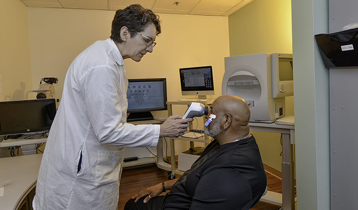 Dr. Machelle Pardue performs an electroretinogram on Army Veteran Michael Brooks, who participated in her study. (Photo by Joey Rodgers)