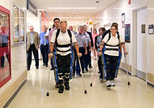 Research participants try out the ReWalk at the Bronx VA Medical Center during a visit by Lt. Gen. Thomas Travis, Surgeon General of the U.S. Air Force.