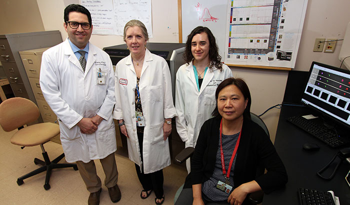 Dr. Achsah Keegan (second from left) and colleagues Dr. Amit Golding, Molly Hritzo, and Dr. Hongjuan Gao are looking at how immune cells respond to house dust mites. The work could yield wider insight on the respiratory problems affecting many Iraq and Afghanistan Veterans. (Photo by Mitch Mirkin)