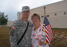 Cheryl Masevicius greets her husband, Rob, on his return from Iraq in October 2007, at Fort Dix.