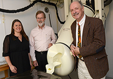 (From left) Drs. Lisa James, Brian Engdahl, and Apostolos Georgopoulos (director) are with the Brain Sciences Center at the Minneapolis VA. They are seen here next to the center's MEG scanner.