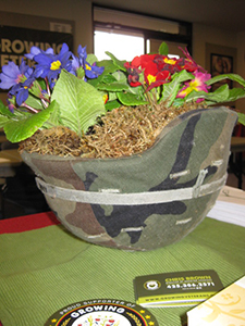 A flower arrangement in a military helmet, made to resemble the logo of Growing Veterans.  (Photo courtesy of Christopher Brown)