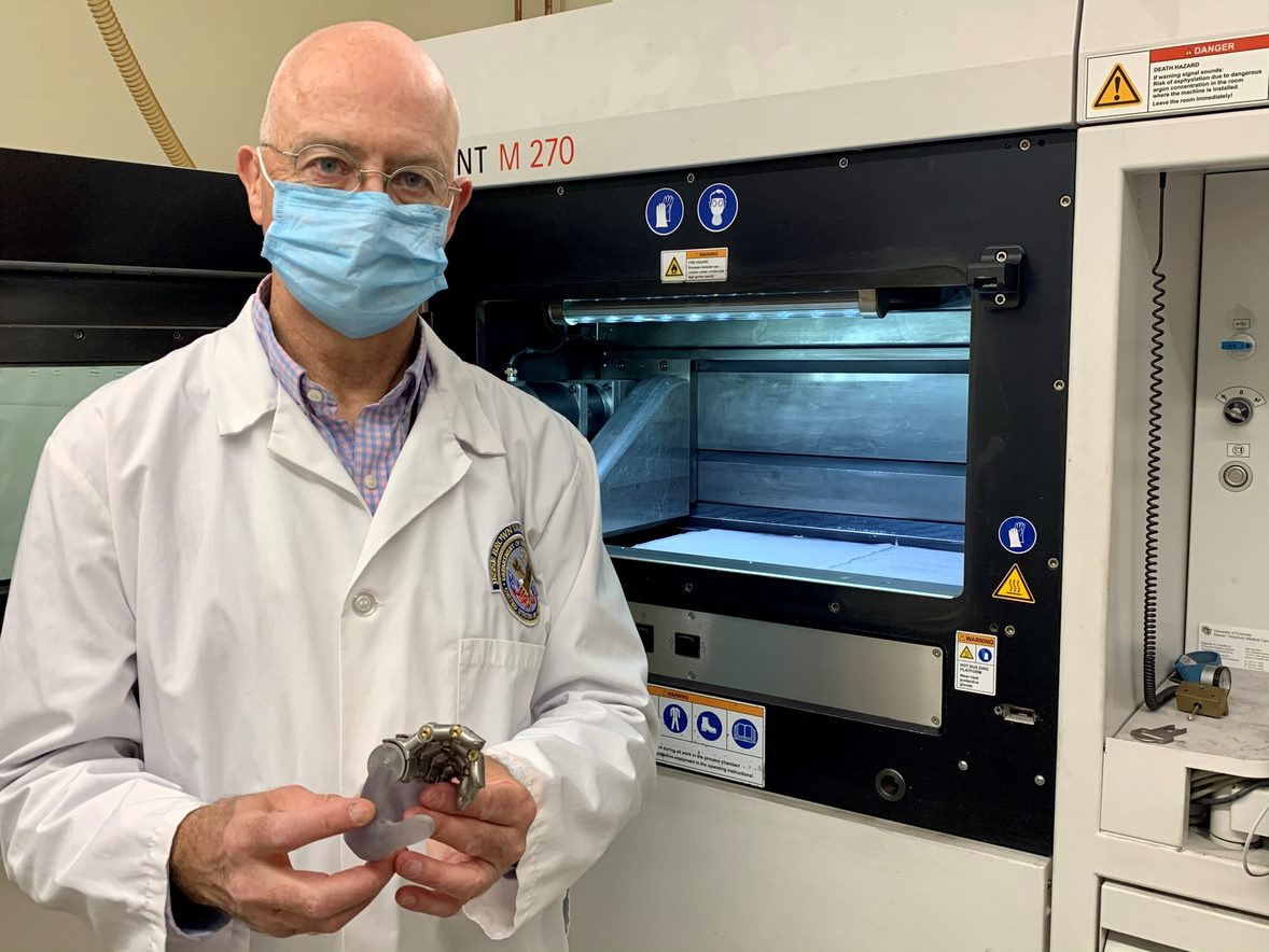 Dr. Richard Weir displays a prototype for one of his ongoing projects. It calls for developing a mechanical finger that can be sized for a female hand using 3D printing technology. (Photo by Terri Rorke)