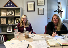 Research assistant Brandy Smith (left) and Behavioral Health QUERI program manager Krissi Morris are working with Dr. Sara Landes on a study evaluating REACH VET. On the shelves in the background are military memorabilia from Landes' family. (Photo by Sara Landes)