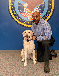 Army Veteran Derrick Tillman, VA's national dog trainer, is responsible for evaluating and approving each dog before it gets matched with a study participant.