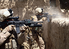 Two Marines with 2nd Battalion, 8th Marine Regiment engage in an operation in Helmand province, Afghanistan, in 2009. Four battalions of Marines took part in a VA San Diego study on heart rate variability, which researchers say is a good measure of the body's fight or flight system. <em>(Photo by Sgt. Pete Thibodeau/USMC)</em>