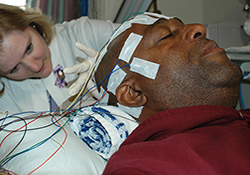 EEG technician Susan Hayes administers testing to an epilepsy study participant at the Durham VA Medical Center.