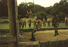Cresci (seen coming down the wall) takes part in an Army training course at Fort Sam Houston in 1991.