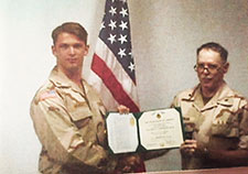 Benzer (left) received the Joint Service Commendation Medal in 1999 while stationed at Eskan Village in Saudi Arabia with the Intelligence directorate of the Joint Task Force-Southwest Asia.