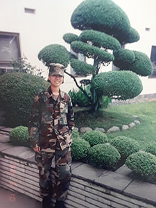 In this 1998 photo, Yani Leyva is outside a building that she and her team were repairing in Camp Zama, a U.S. Army post in Japan.