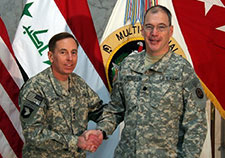 Russell (right) is pictured with Gen. David Petraeus, who commanded all coalition forces in Iraq in 2007 and 2008.