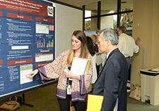 At a VA Research Week event at the Dorn VA Medical Center in Columbia, S.C., Dr. Katherine Blissit talks about her group's research findings with Dr. Alex Chiu of VA's national Office of Research and Development. The study concerned the use of benzodiazepines  in patients with PTSD.
