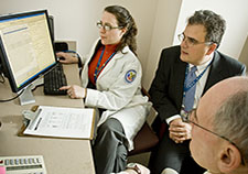Dr. David Oslin (center), with VA and the University of Pennsylvania, is leading a study on the use of genetic results to guide depression treatment. At the computer is VA nurse Trisha Stump. <em>(Photo by Tommy Leonardi)</em>