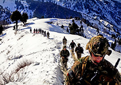 U.S. soldiers and Afghan border police hike along the Afghanistan-Pakistan border in early 2013. (U.S. Army Photo by Sgt. Jon Heinrich)
