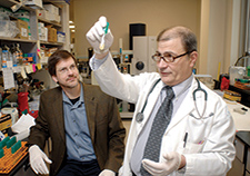 Cleveland VA researcher Dr. Robert Bonomo (right) and colleague Dr. Mark Adams, now with the J. Craig Venter Institute, have been studying the genetic make-up of <em>A. baumannii</em>, a species of bacteria that is resistant to most antibiotics. <em>(2009 photo by Tim Harrison)</em>