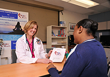 Dr. Karen Saban and research participant Bianca Calhoun discuss the MBSR program. <i>(Photo by Daniel DuVerney, Edward Hines, Jr. VA Hospital, Chicago)</i>