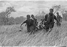 Marines of Company E, 2nd Battalion, 9th Marines, perform a medical evacuation during a heavy firefight with the North Vietnamese Army in July 1967. <em>(USMC photo via Wikimedia Commons) </em>