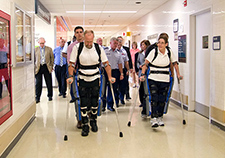 Research participants try out the ReWalk at the Bronx VA Medical Center during a visit by Lt. Gen. Thomas Travis, Surgeon General of the U.S. Air Force. <em>(Photo by Lynne Kantor)</em>