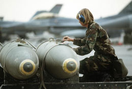 female soldier near fighter jet
